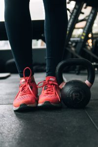 feet with kettlebell for exercise